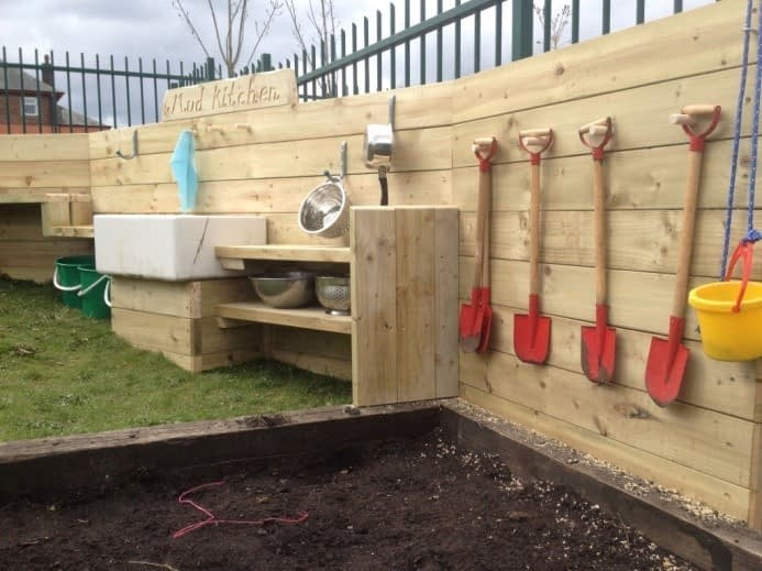 A mud kitchen needs mud: I like the idea of having a space to dig, rather than letting the boys have free reign over the whole yard. I also like the shovels and pails.